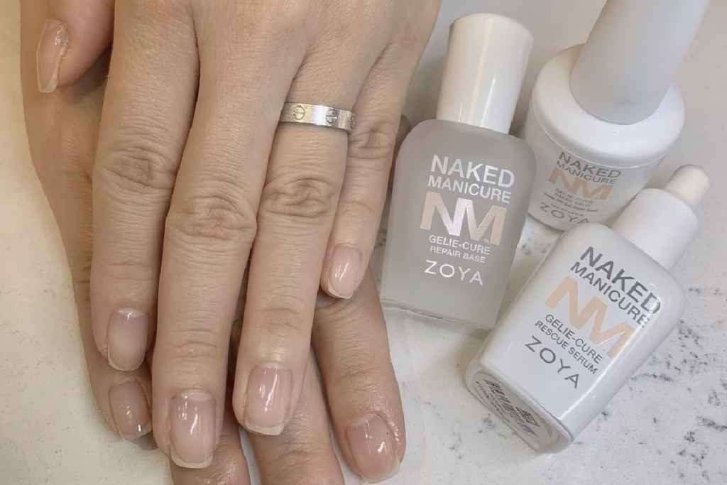 Two hands placed on top of each other next to the ZOYA Rescue Serum, Repair Base, and Gelie Cure to show the Gelie Cure Foundation Manicure on bare nails.