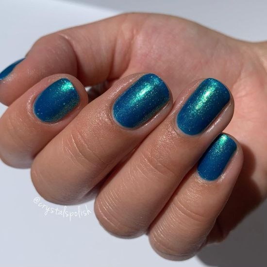 A hand showing the color Summer by Zoya on her fingernails.