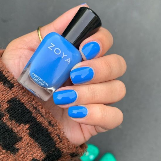 A hand showing Mateo by Zoya worn on the fingernails.