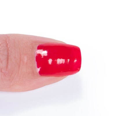A nail painted with a red Zoya polish and no Gelie-Cure used.