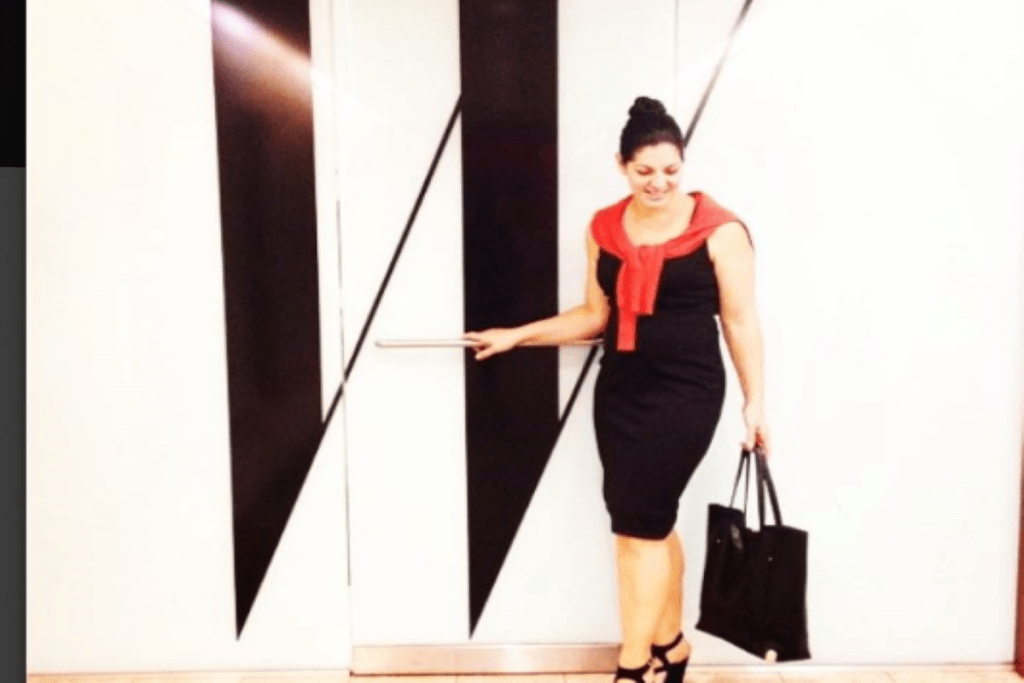 Rebecca Isa, Creative Director of ZOYA Nail Polish, is standing in front of W Magazine in New York.