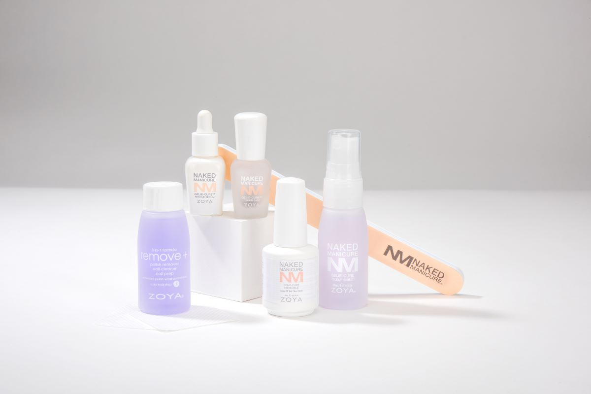 A grouping of products in Naked Manicure nail system kits, including Remove +, Rescue Serum, Repair Base, Naked Gelie, Clear-Shine and a 3-way-file.