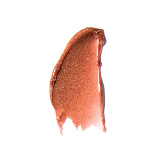 A lip gloss smear of ZOYA Hot Lips in Chance.