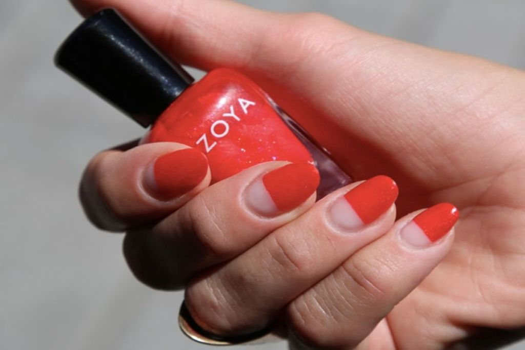 A negative space red manicure by @lemanoir using ZOYA Aphrodite.