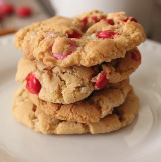 Coconut Chocolate Crunch Cookies image of 4 cookies baked golden brown with m & m's