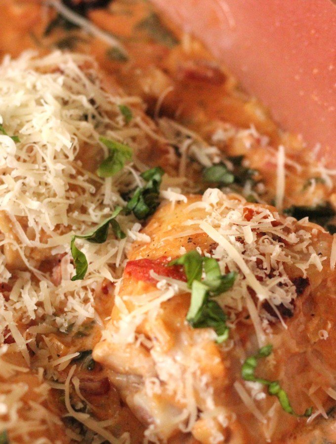 Creamy chicken and spinach topped with parmesan and basil