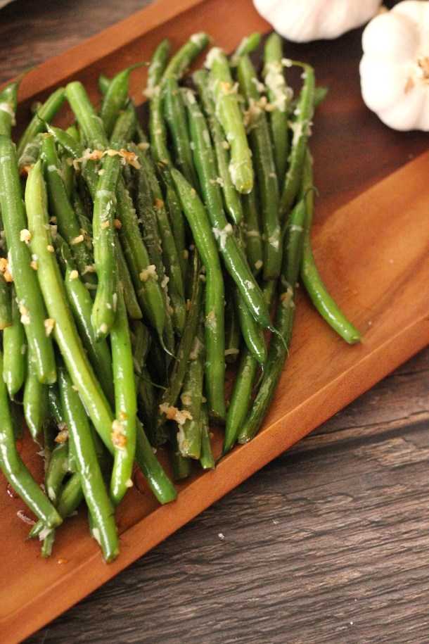 Garlic Parmesan Green Beans cooked on a wooden platter