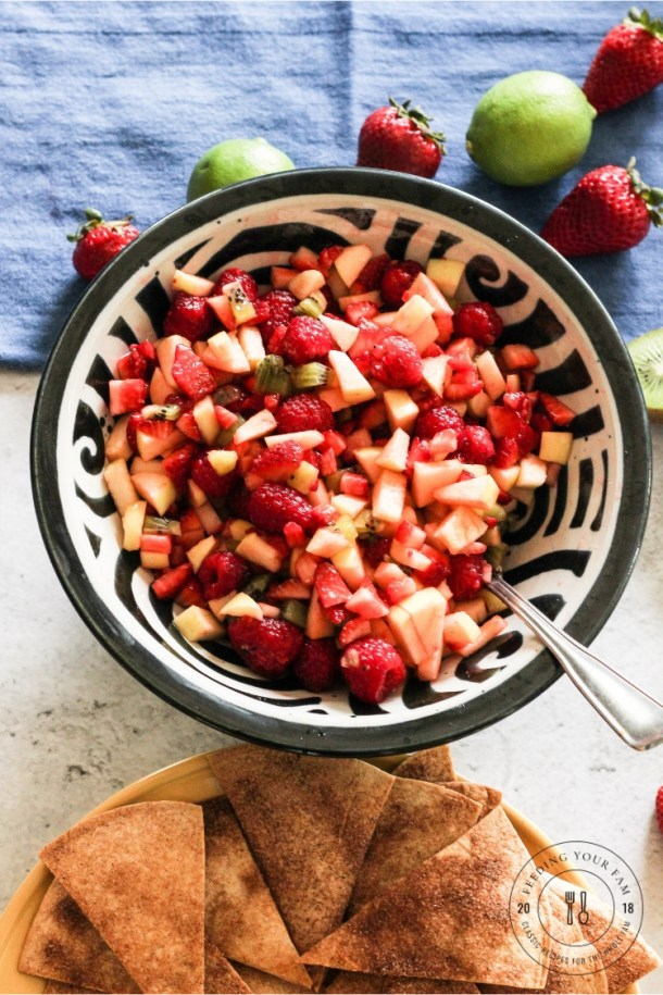 Fruit salsa in a bowl with cinnamon chips