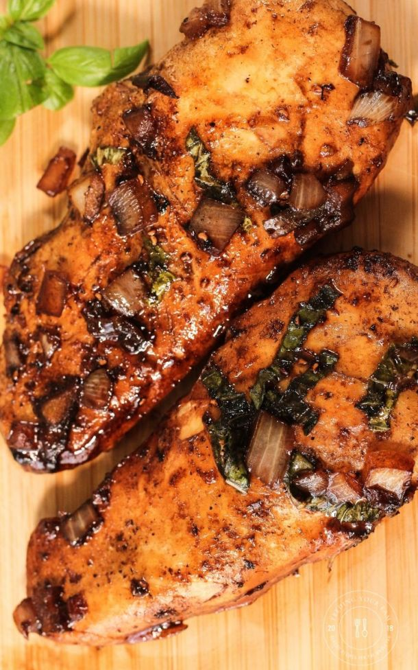 cooked chicken on a wooden cutting board