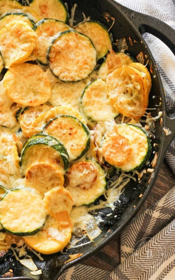 sauteed zucchini and yellow squash in a cast iron pan