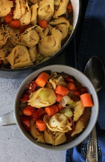 tortellini soup in a gray bowl