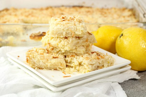 stack of creamy lemon bars on a white plate