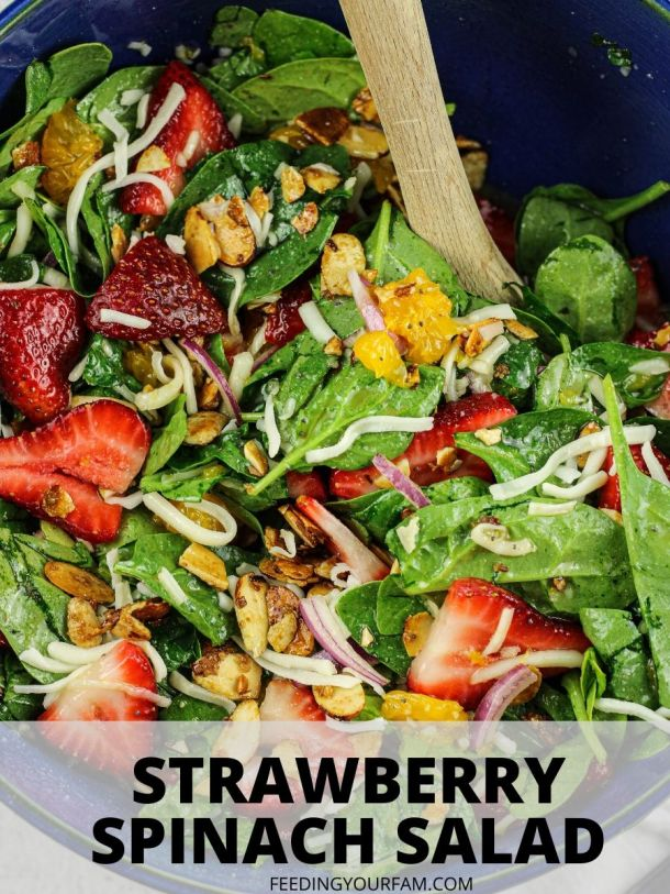 strawberry and spinach salad in a blue salad bowl