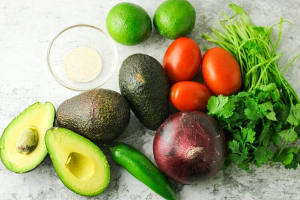 avocados, red onion, cilantro, tomatoes, limes and jalapeno