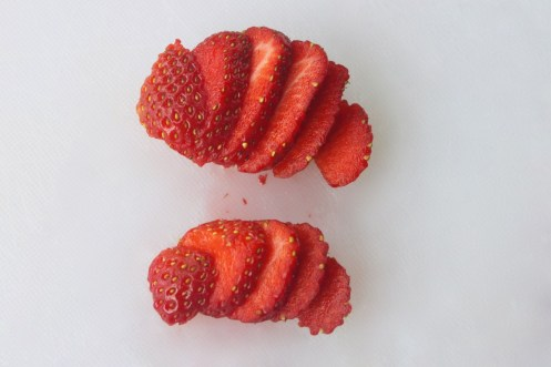 sliced strawberries for dehydrating, www.feedthemwisely.com