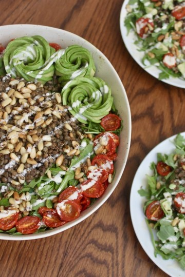 vegan arugula lentil salad with cumin toasted pine nuts oven-roasted tomatoes and avocado