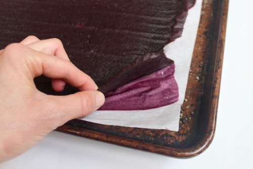 checking to see if blueberry fruit leather is finished baking