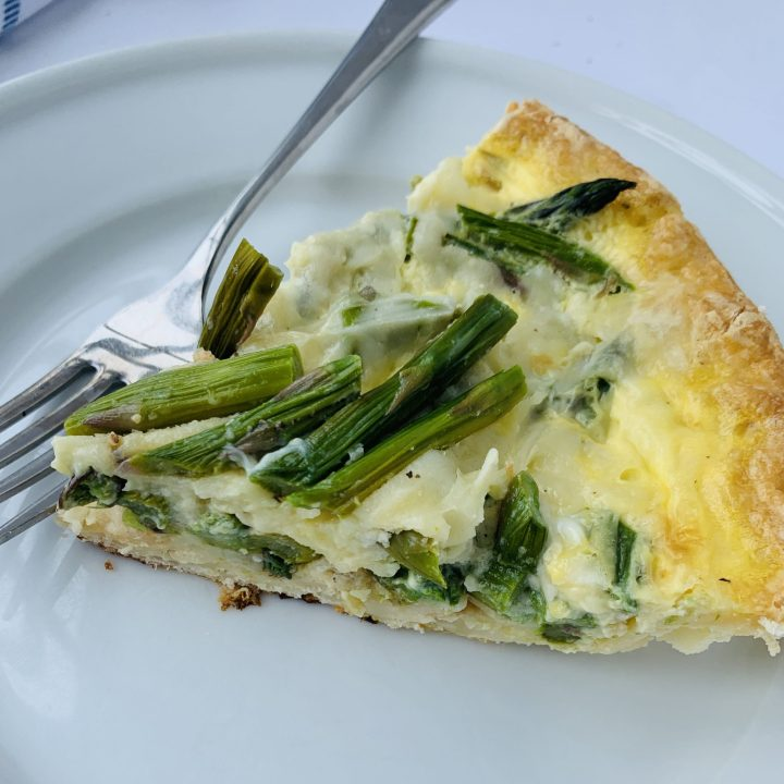 Shows the texture of asparagus and cheese quiche