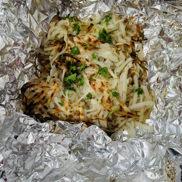 Shows texture of grilled foil potatoes.