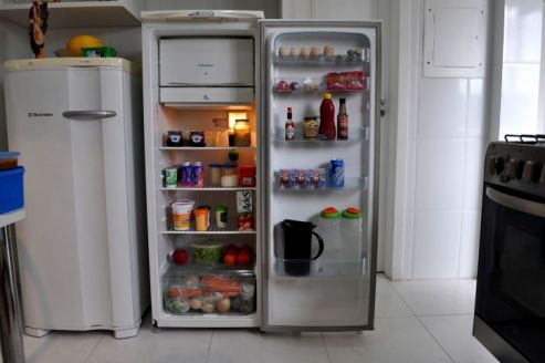 refrigerator-in-the-kitchen-with-food-725x482