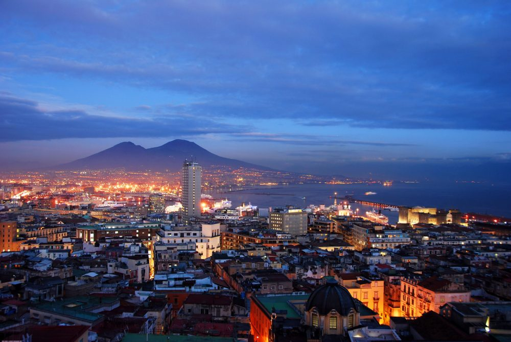 Naples, Italy after sunset with Mount Vesuvius