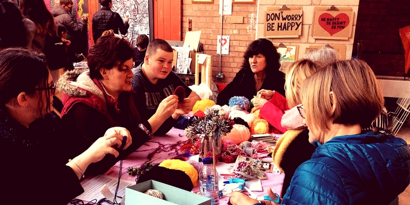 Photo Of People Making Pom Pom at The Festival