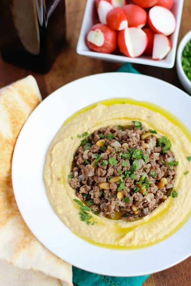 My Lebanese Hummus with Ground Beef is a recipe I learned from my parents. It's simple and authentic and topped with ground beef and pine nuts!