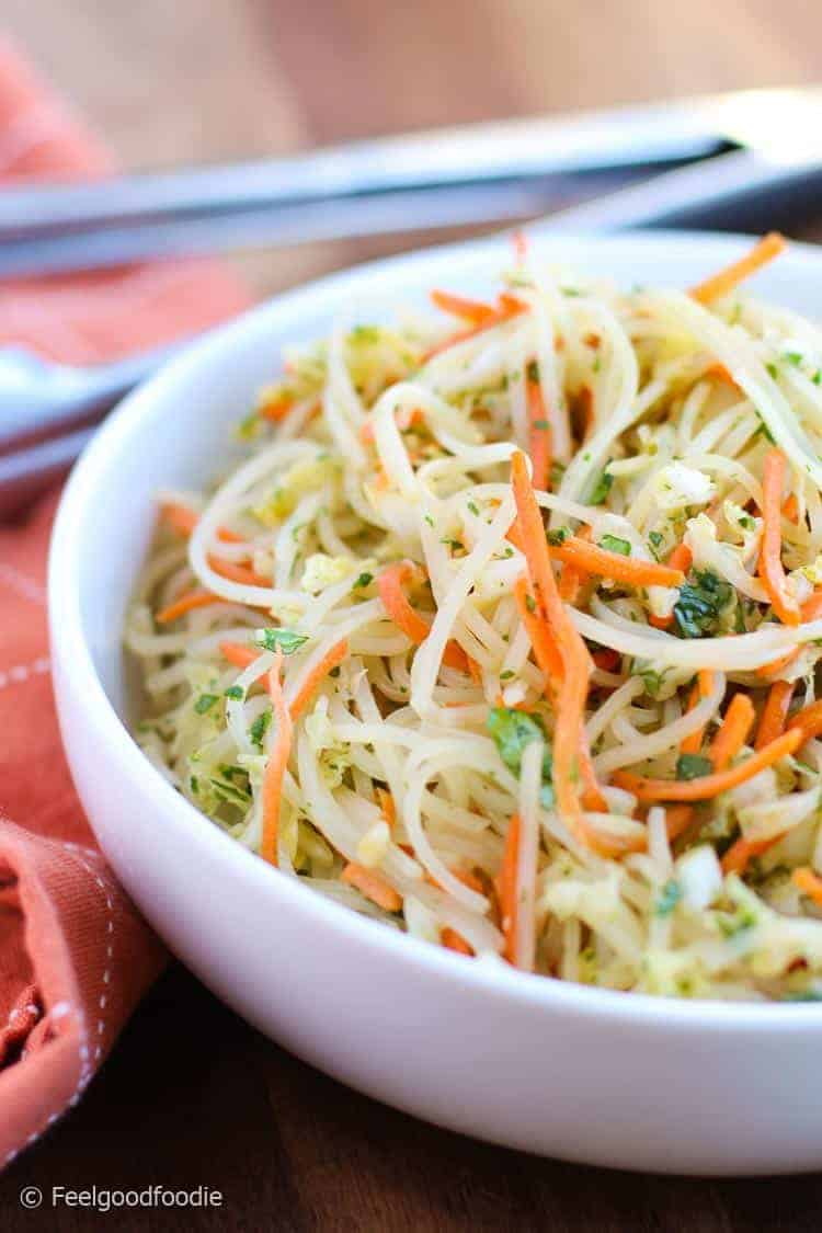 This recipe for Gluten Free Asian Noodle Salad is easy to throw together with rice noodles, napa cabbage, carrots & cilantrol tossed in an easy Asian sauce