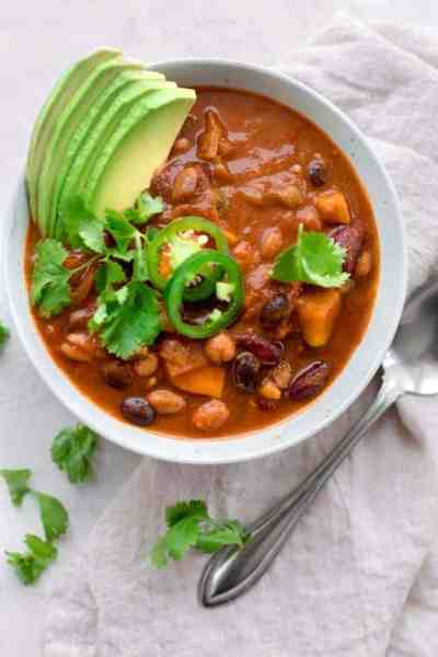 This Vegetarian Sweet Potato Chili is basic in ingredients but totally sophisticated in taste - it has a smoky and sweet flavor and packed with protein for a vegan and gluten-free meal you'll want to make and eat all throughout the fall and winter! Avocado {NOT} optional ;)