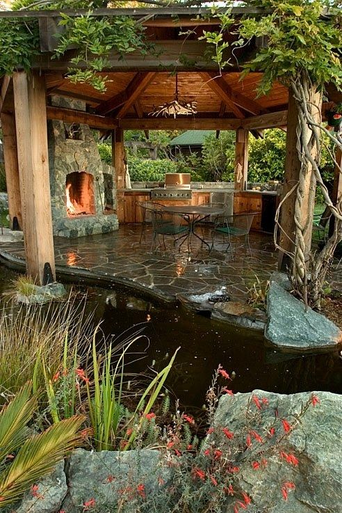 Amazing Outdoor Kitchens That You Might Have While Living ... on Outdoor Kitchen Living Spaces id=81130