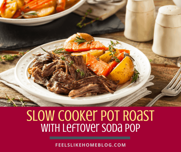 pot roast on a plate with carrots and potatoes
