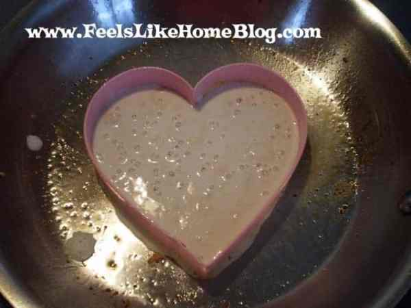 A heart shaped cookie cutter with Pancake and chocolate chips