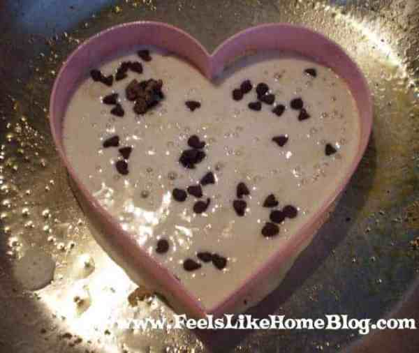 A heart cookie cutter with Pancake and chocolate chips