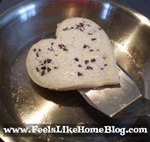 A pan filled with food, with Pancake and heart shaped