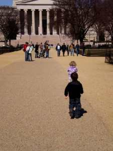 Two small children running on the National Mall