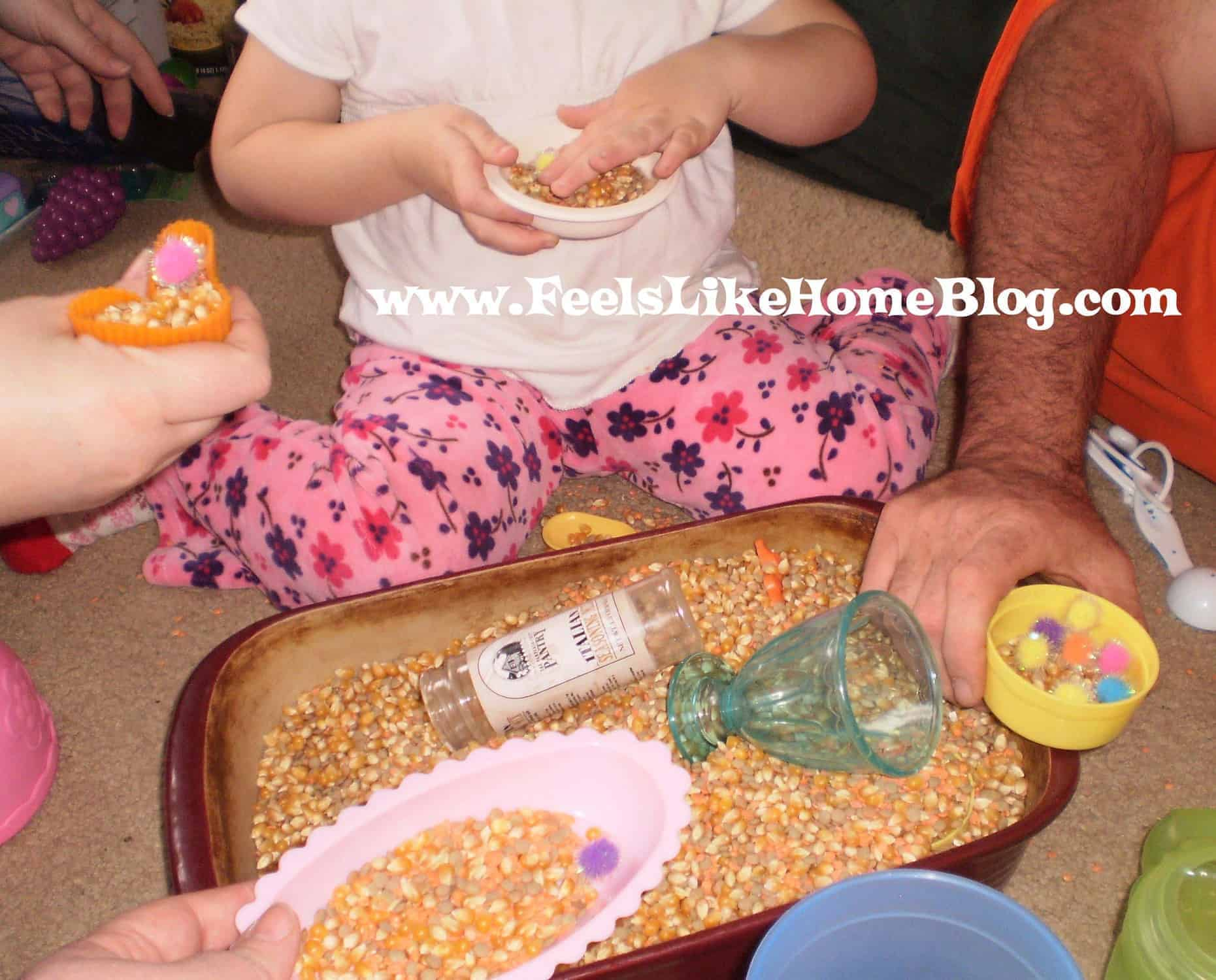 whole family playing in sensory tub