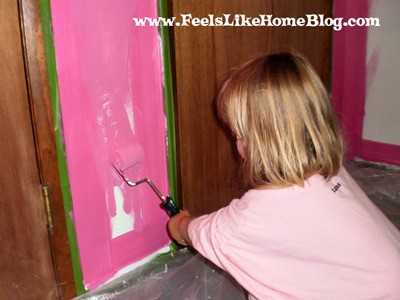 Grace painting the walls hot pink.