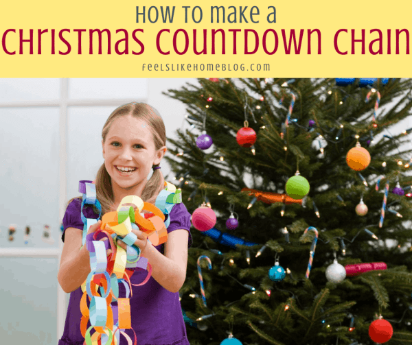 a girl with a countdown chain and a Christmas tree
