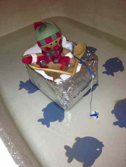 elf on a shelf in a boat in the bathtub