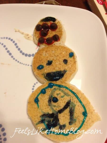 A pancake made to look like a snowman