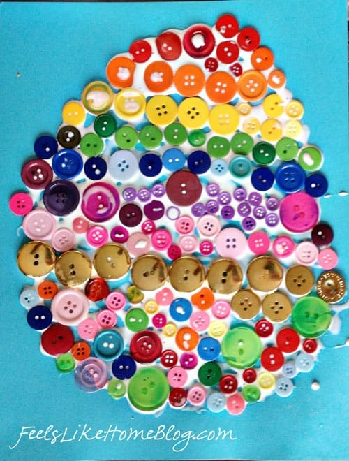 A close up of the rainbow egg made out of buttons