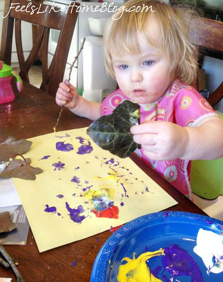 A little girl looking excited to paint