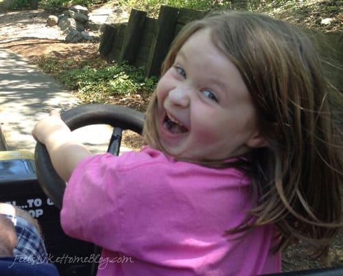 A little girl driving a car