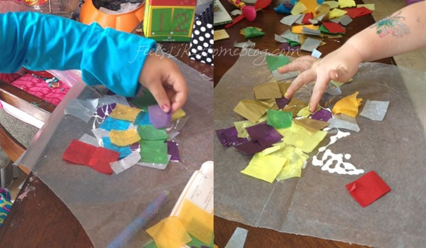 Applying tissue paper to wax paper to make a suncatcher