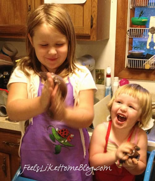 Two little girls excited to squish their astronaut pudding