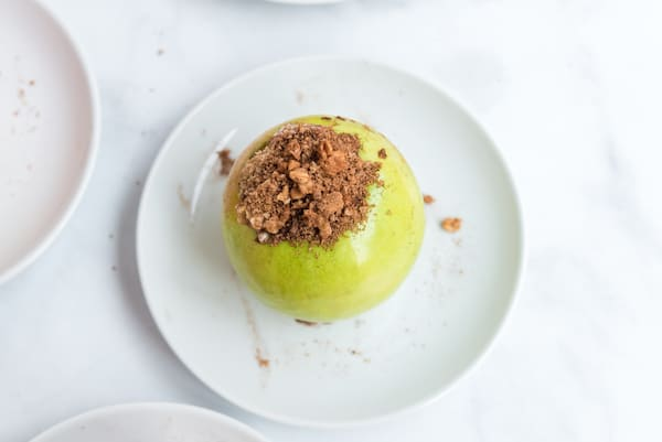 one green apple stuffed full of brown sugar and cinnamon