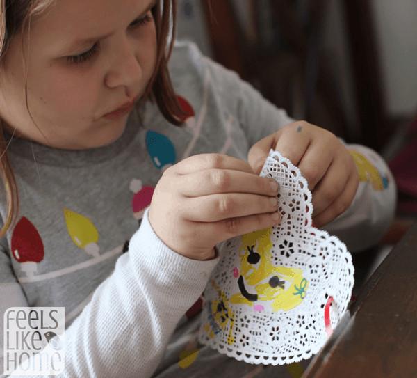 threading-doilies-on-ribbon