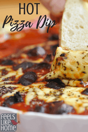The best hot pizza dip, originally from a Pampered Chef recipe - Simple and easy with cream cheese and pizza sauce, this dip is the perfect appetizer. Low carb and gluten free. Great with pepperoni, olives, mushrooms, or other pizza toppings. Perfect food for the Super Bowl or parties. Kids love this too. Lots of mozzarella cheese.