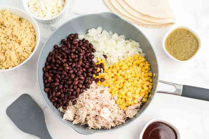 add beans, corn, and chicken to onions