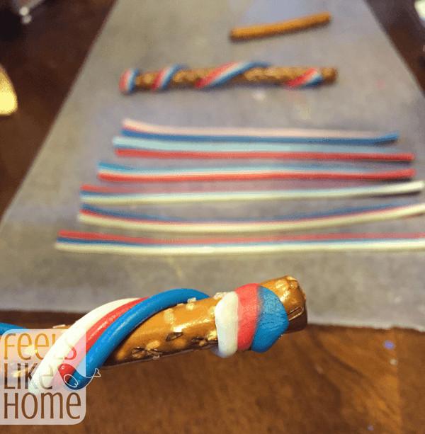 Wrap the candy around the pretzel stick